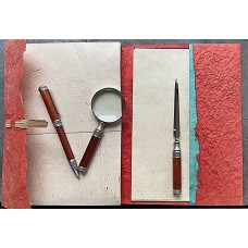 Set ballpoint pen, letter opener and magnifying glass